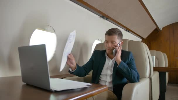 business man talking by mobile phone partner connection aircraft jet travel