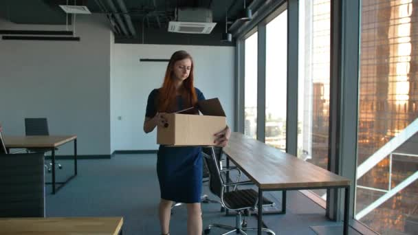 Redhair business woman leave the office after being fired