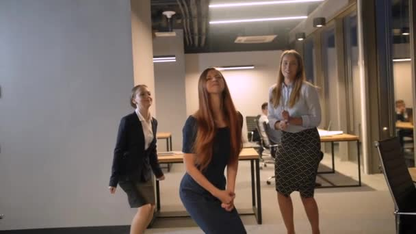 Three businesswomen Jumping Happy Celebraing Success In Modern Coworking Center, Team Successful Cheering Slow Motion