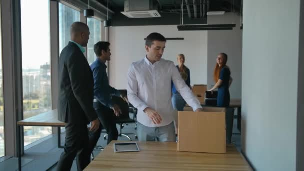 Entrepreneur unpack boxes and look at road drawings in modern office