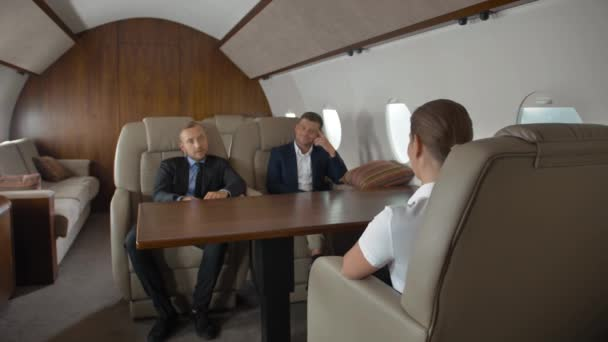 Premium view of businesspeople have meeting in corporate aircraft