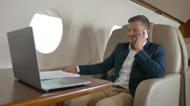 mature entrepreneur talking by mobile phone partner connection aircraft jet travel