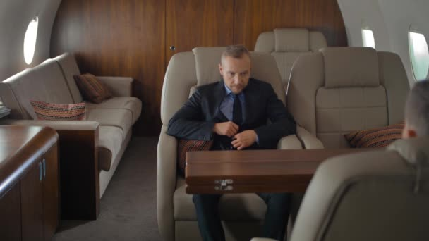 Businessman inside of private jet luxury interior