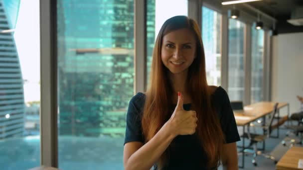 Get like. Optimistic Businesswoman Makes Hand Gestures Thumb Up Sign in Office