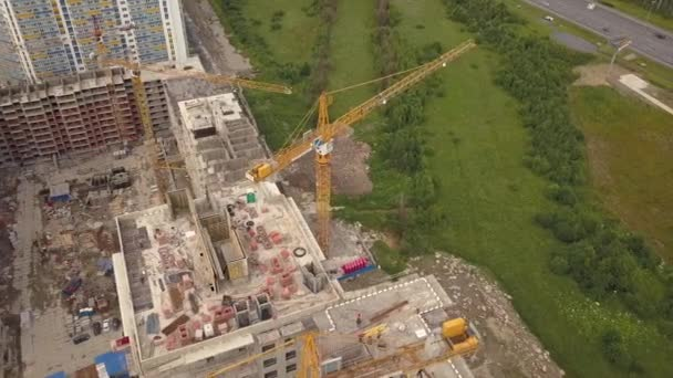 Aerial shot of crane, construction new modern building work builders and technicals