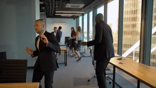 Caucasian and african american businesspeople dancing at co-working office