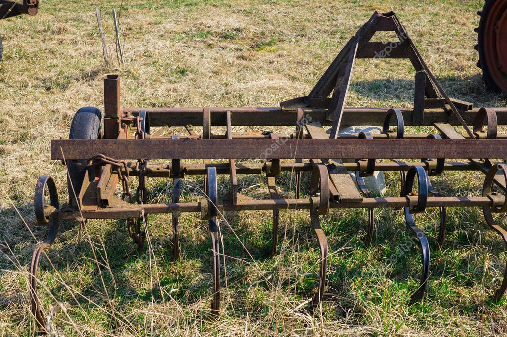 Old equipment for agricultural work in the field. On the farm.