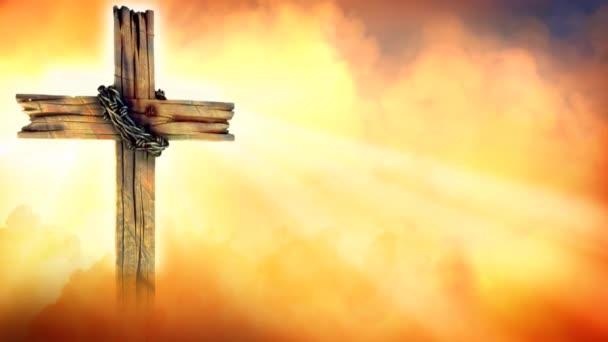 Zlatý kříž silueta ráno s paprsky světla 4k Loop nabízí zlaté mraky a kouř přesun celé scény a po dřevěný kříž