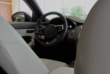 Between front leather seats inside a car with combined black and white upholstery