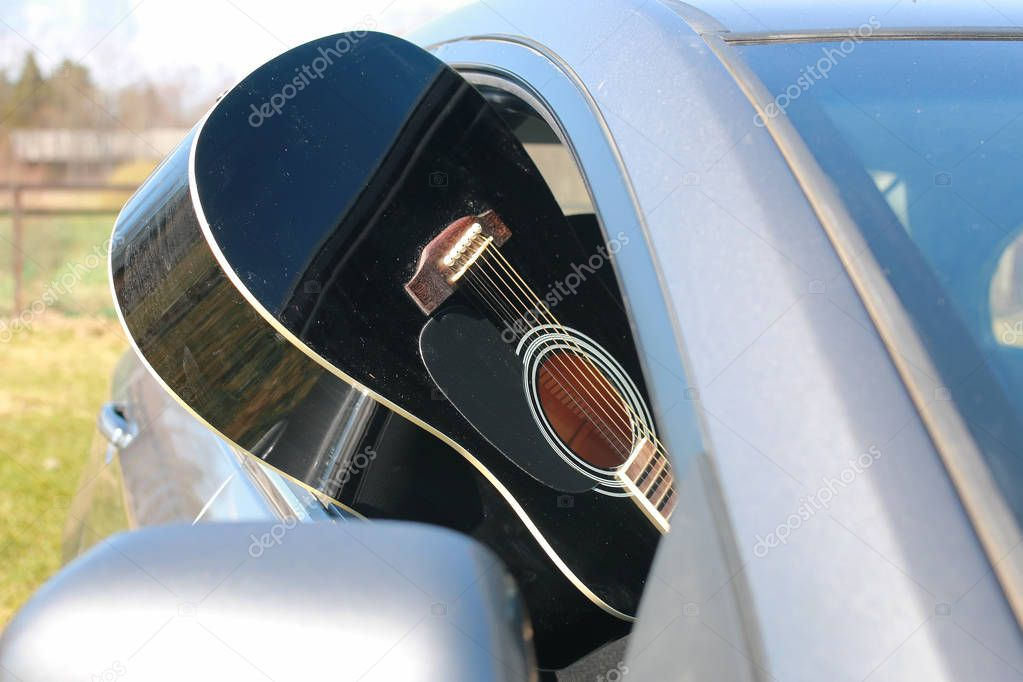 guitar outdoor near car