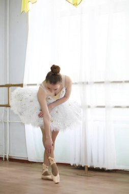 Pretty girl ballet dancer practicing