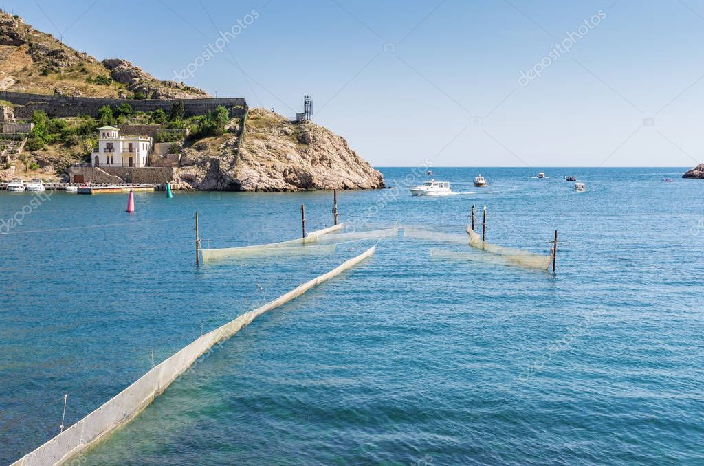 View of the sea bay. Protective networks. Republic of Crimea, Balaclava. 11.06.2018: Balaklava Bay, access to the open sea
