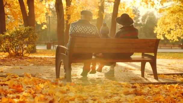 Family enjoying sunset in the autumn park