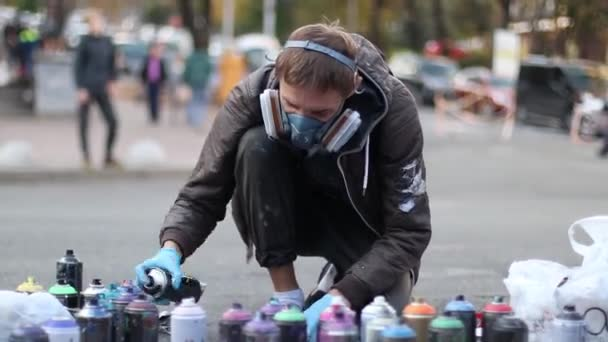 Ukraine, Kiev september 2018 street artist draws graffiti on the pavement