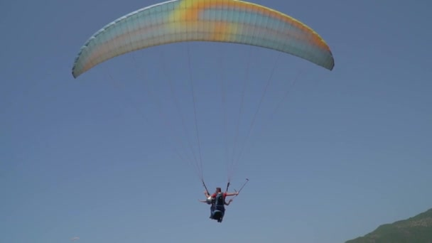Tourists take a flight on paragliding