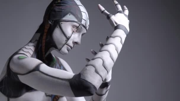 A cyborg woman comes to life, looks around and freezes