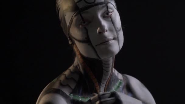 Slim futristic cyborg with white lenses posing on camera