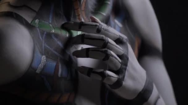 Shooting close-up, a woman cyborg touches herself with her hands, self-awareness