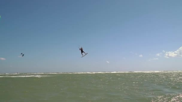 Extreme kitesurfing man jumps high into the air