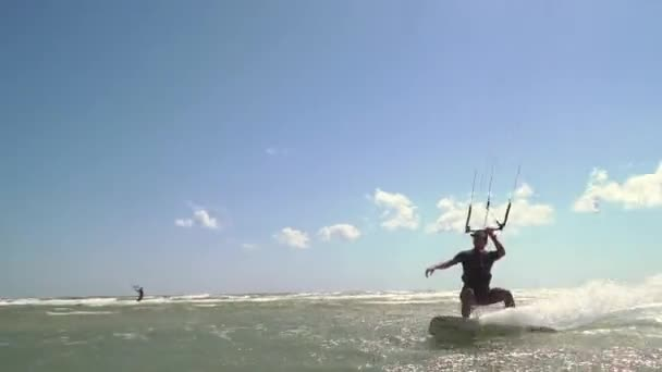 Extreme kiteserfing in the ocean on a summer day