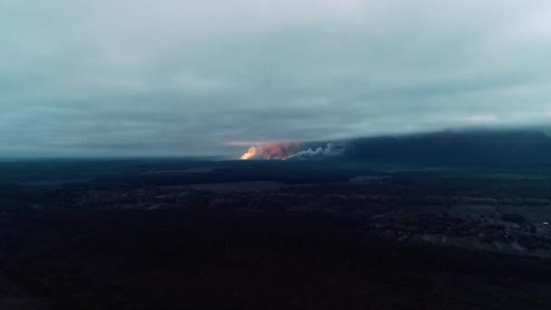 Scary explosions near the countryside cover up the sky with the smoke, aerial shot