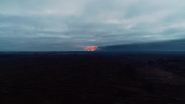 Timelapse of multiple explosions on the horizon, aerial shot