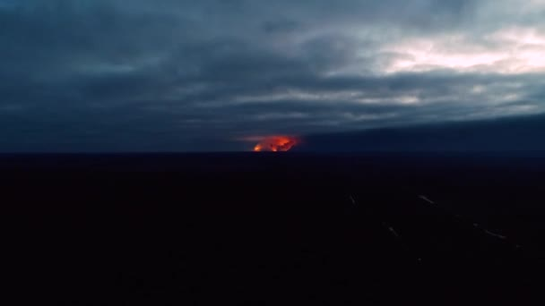 Fascinating explosions far away in the dark, aerial shot