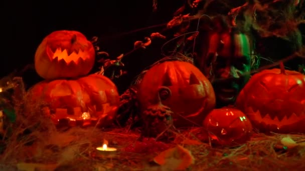 Spooky undead among halloween carved pumpkins screams
