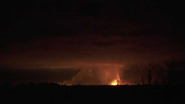 Natural cataclysm wildfire, bright light, smoke and lightnings, aerial shot