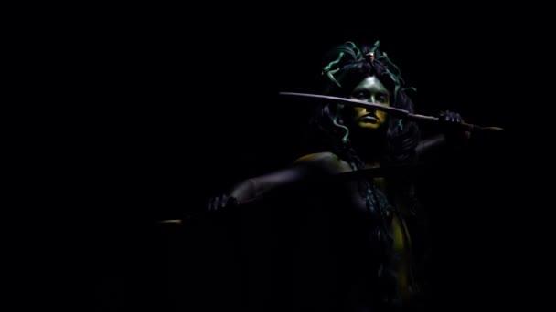 Legendary Medusa waving her blades on black background