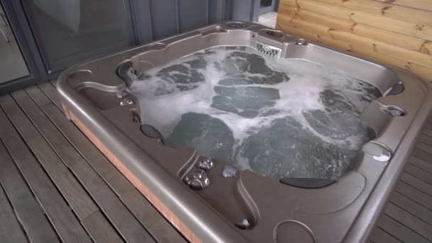 Relaxing jacuzzi with bubbles in the luxury hotel
