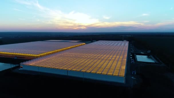 Beautiful sunset on the horizon with greenhouses up front