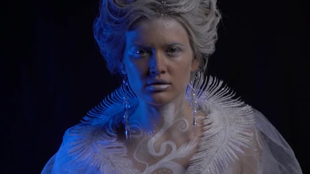 Beautiful Snow Queen blows the snow from her hand