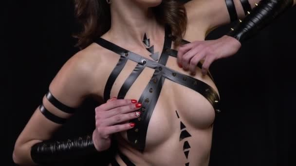 Hot woman with amazing figure, black tape covering her body, close up