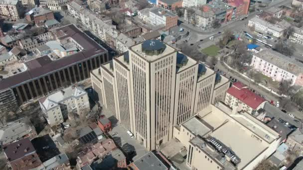 Aerial footage of a massive office building, modern architecture