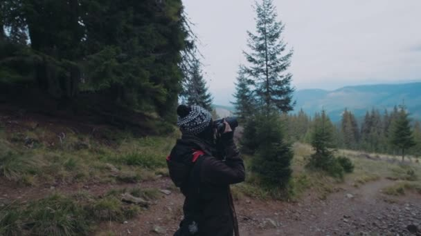 female photographer taking photos in forest