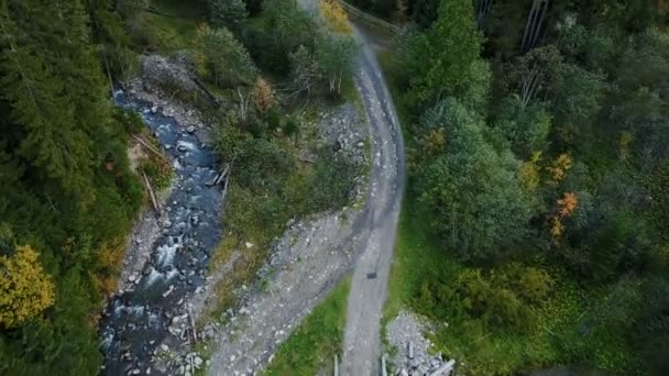 Aerial drone view of amazing autumn forest and river in mountains