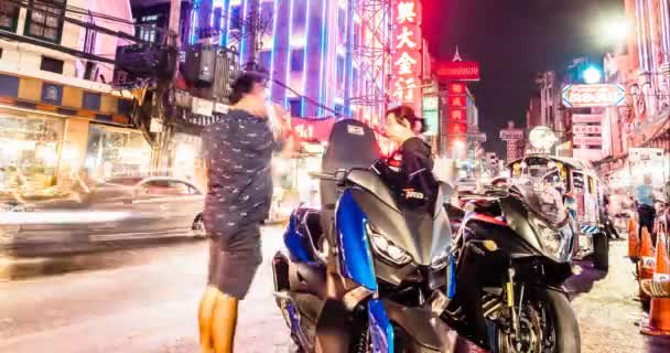 Bangkok, Thailand - May 8, 2019: 4k timelapse with high frame rate The movement of cars andp people in the night asian city. Lights of a big city. Chinatown is the big market shopping and foods street