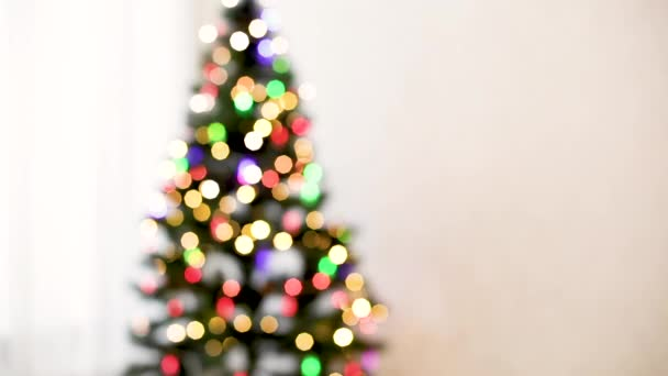 Merry Christmas! Christmas tree with toys and luminous garlands. Beautiful blurred background.