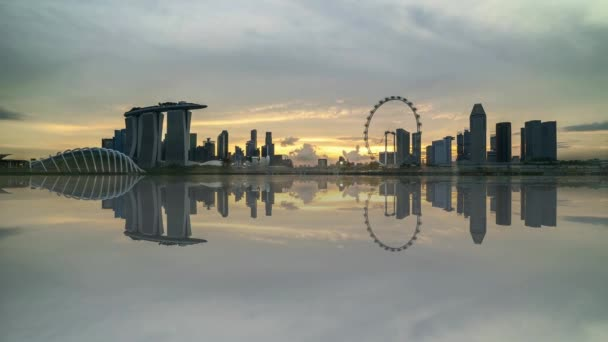 4k UHD time lapse of beautiful sunset at Marina Bay Singapore city skyline with reflection effect.