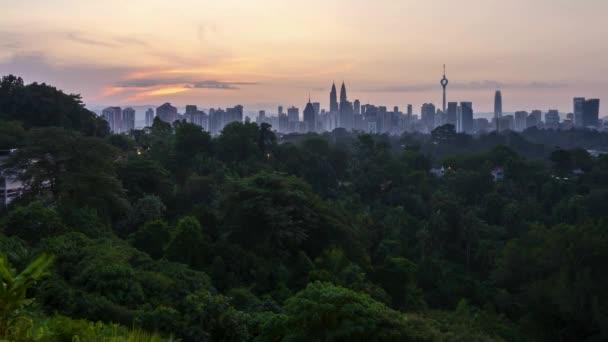 4k time lapse of sunrise from the horizon of Kuala Lumpur city skyline. Tilt up