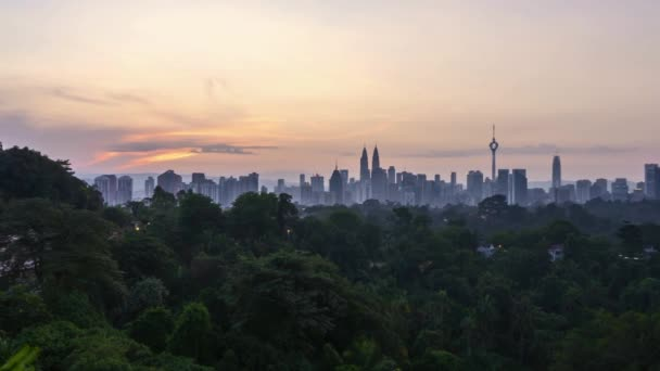 4k time lapse of sunrise from the horizon of Kuala Lumpur city skyline. Zoom in