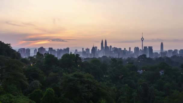 4k time lapse of sunrise from the horizon of Kuala Lumpur city skyline. Zoom out