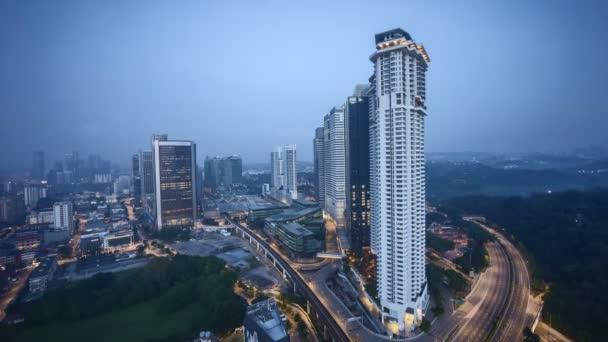 Sunrise at Kuala Lumpur city skyline. Tilt down