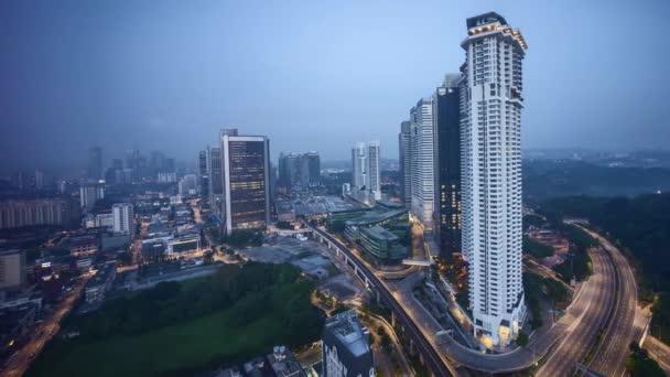 Sunrise at Kuala Lumpur city skyline. Pan right