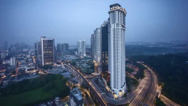 Sunrise at Kuala Lumpur city skyline. Pan left