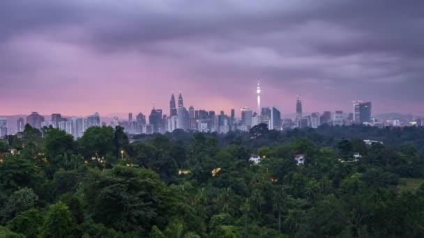 Sunrise at Kuala Lumpur city skyline. 4k UHD time lapse. Pan right
