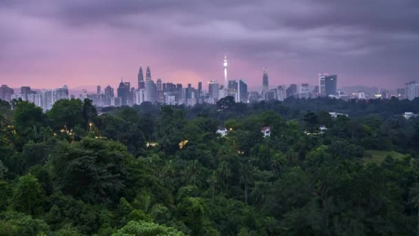 Sunrise at Kuala Lumpur city skyline. 4k UHD time lapse. Tilt up