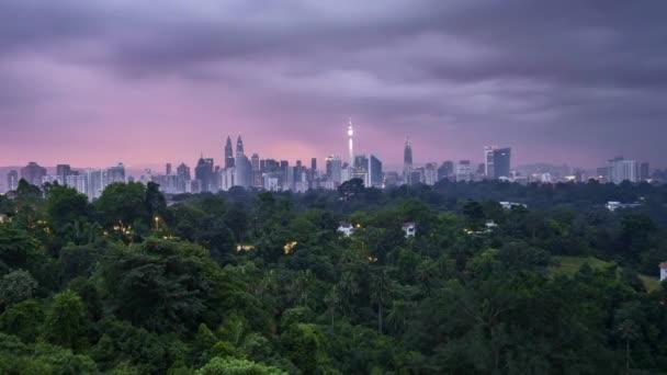 Sunrise at Kuala Lumpur city skyline. 4k UHD time lapse. Zoom in