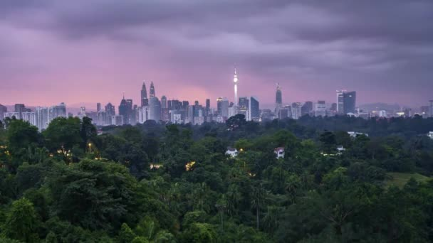 Sunrise at Kuala Lumpur city skyline. 4k UHD time lapse. Zoom out